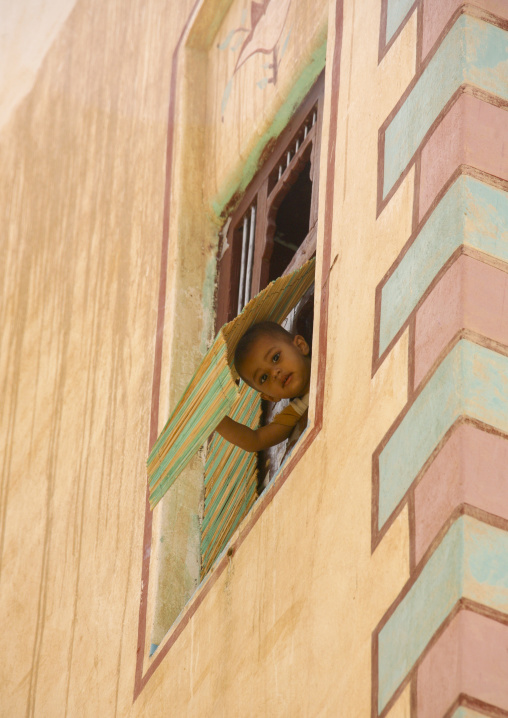 Boy Looking Out From The Window Of A Traditionally Painted Building, Wadi Doan, Yemen