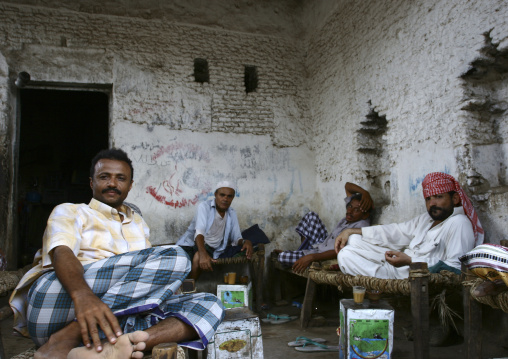 Men Resting And Drinking On Wooden Banks In A House, Zabid, Yemen
