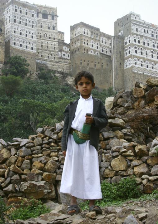 Little Boy Holding  A Jambiya In Front Of Al Hajjara, Yemen