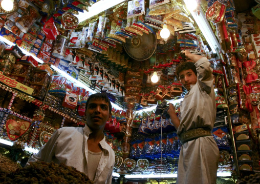 Two Candy Sellers Standing In Their Shop, Old Souq Of Sanaa, Yemen