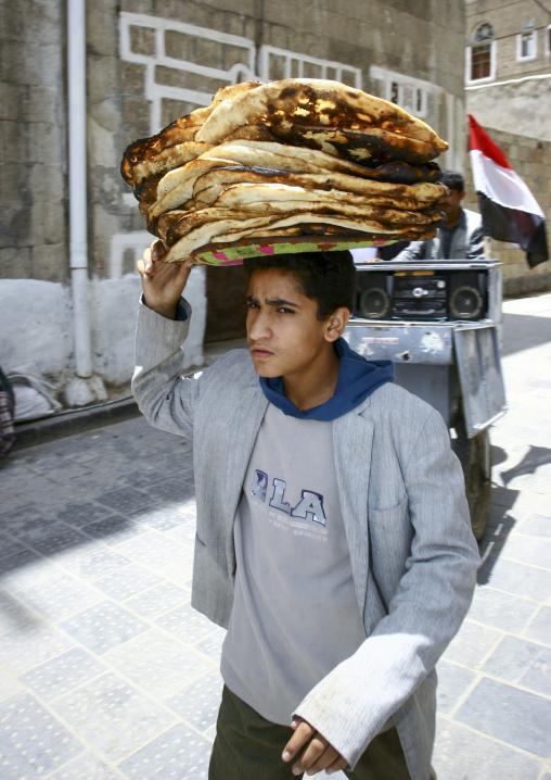 Boy Holding A Plate Of Bread, Sanaa, Yemen