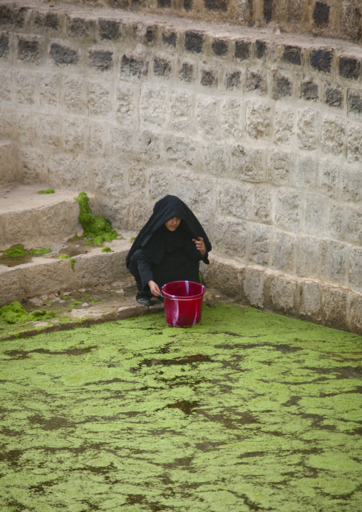 Woman Taking Water From A Cistern Covered By Lentils, Shahara, Yemen