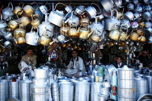 Shop Keepers Selling Coffee Pot, Huge Kettles And Other Crockery, Sanaa' Souq, Yemen