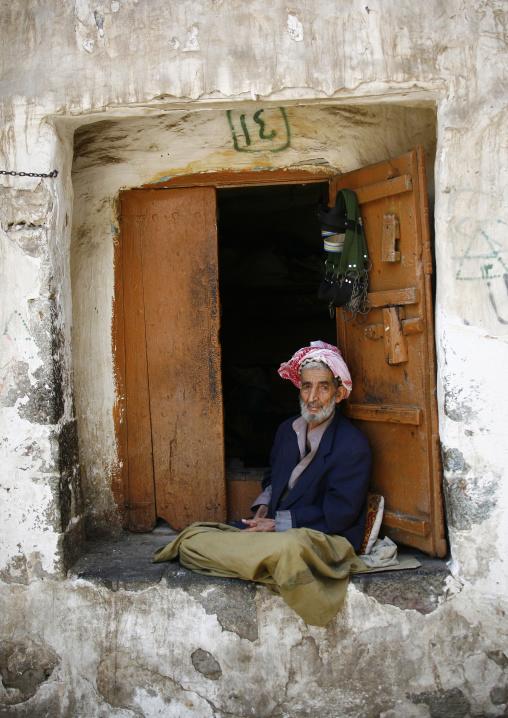 Smiling Old Yemeni Man Selling Khat Sitting Outside His Shop, Sanaa, Yemen